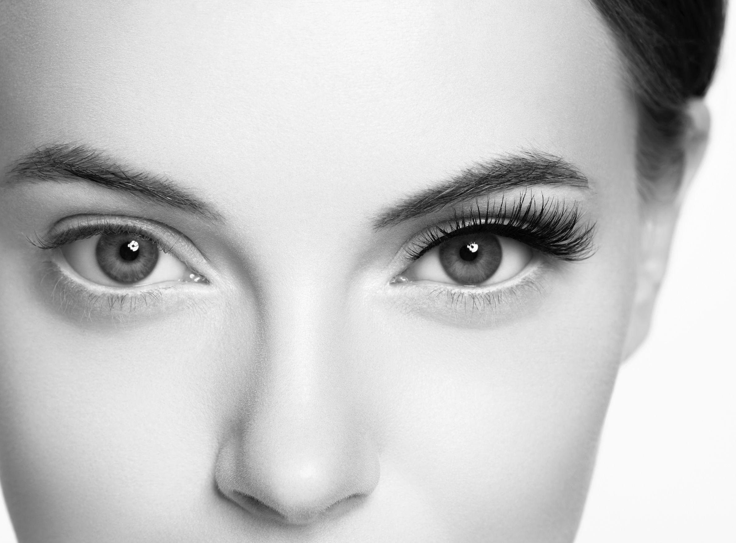 Eye lashes, lash extension woman  lashes close up macro monochrome. Studio shot.